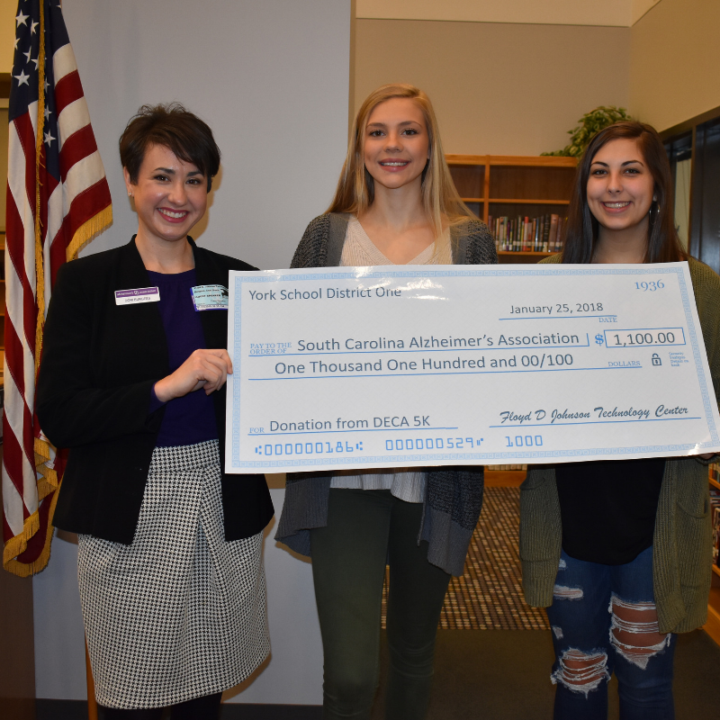 FDJTC students present check to SC Alzheimer's Association.