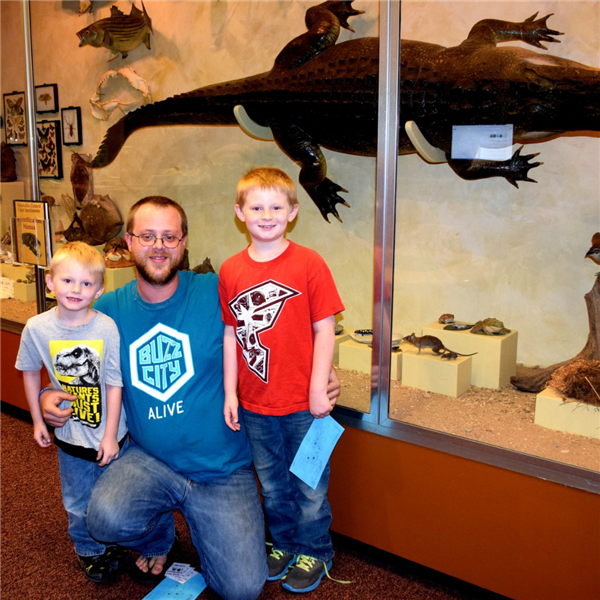 A father and 2 children in the Museum of York County